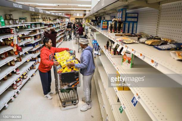 People stock up on groceries at the Stop and Shop in South Bay on March 14, 2020 in Boston. Despite beautiful weather, many folks were found inside -...