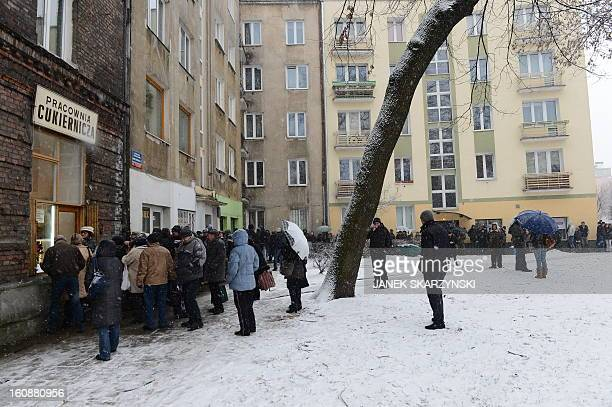 People stood in line for some six hours in subfreezing temperatures in front of a popular sweet shop in Warsaw to get the cakes jamfilled doughnut...