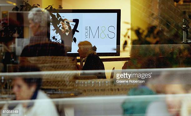 People stop for having coffee at Marks and Spencer AGM in the Royal Festival hall on July 14 2004 in London Billionaire Philip Green urged Marks...