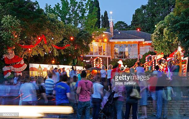People stop to admire Christmas festive lights displayed on a house at The Boulevard Christmas Lights Display on December 22 2009 in Ivanhoe on the...