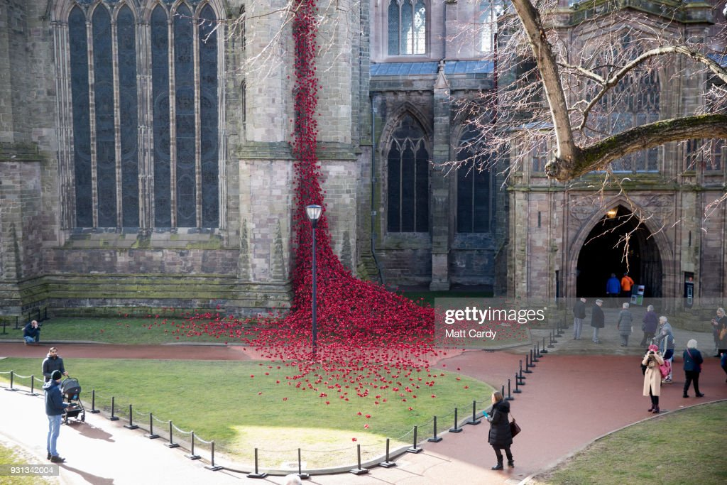 People stop to look as the Weeping Window opens at Hereford Cathedral as part of the final year of the 14-18 NOWs UK-wide tour of the poppies on March 13, 2018 in Hereford, England. The display of handmade poppies, called The Weeping Window, was put in place by a team under instruction of designer Tom Piper and artist Paul Cummins, first went on display at the Tower of London in 2014 and has since been on a tour of the country.