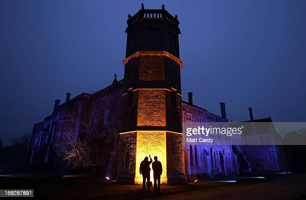 People stop to look at the illuminated front of Lacock Abbey as part of a new installation 'Into the Light Illuminating Lacock Abbey' on January 10...