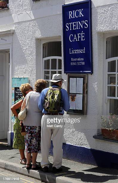 People stop to look at the menu outside Rick Stein's cafe on August 19 2013 in Padstow England Over recent years the traditional Cornish fishing...