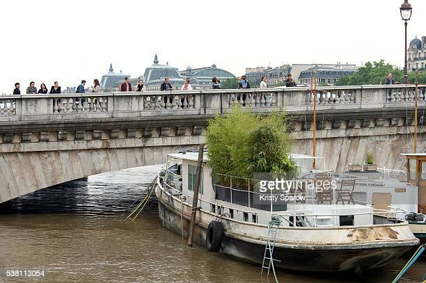 People stop to look at the now gradually receding rainswollen River Seine in Paris after the waters reached the highest levels in three decades on...