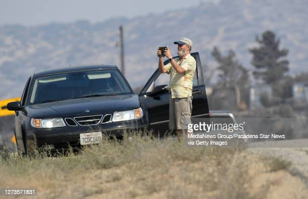 People stop to take pictures along the road during the Bobcat Fire in Juniper Hills on Saturday September 19 2020