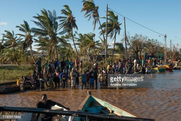 People stranded by Cyclone Idai wait for rescue by the Indian Navy on March 22 2019 in Buzi Mozambique Thousands of people are still stranded after...