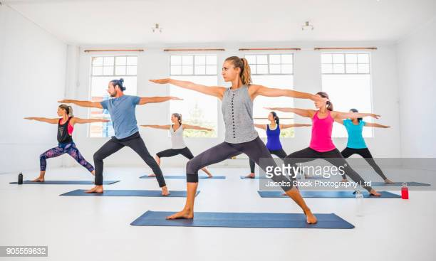 People stretching in yoga class