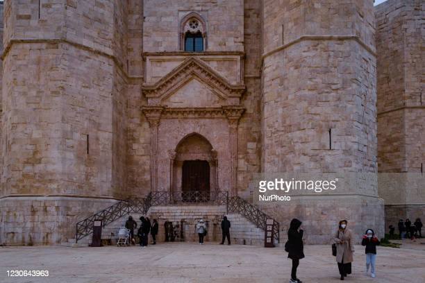 People stroll after visiting the Castel del Monte in Andria on January 17, 2021. In Puglia today the Orange Zone began according to the last DPCM....