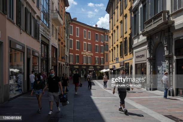 People stroll along a pedestrian street in the Lower Town on June 18, 2020 in Bergamo, Italy. The city of Bergamo is slowly returning to normality...