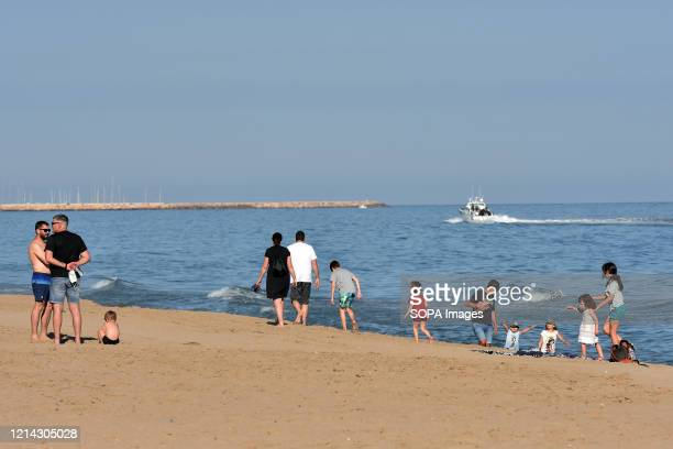 People stroll and play along Calafell beach during the final confinement of Phase One Calafell is in Phase One of the end of confinement but with...