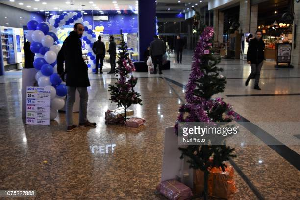 People stroll at a shopping center in Ankara Turkey on December 27 2018 A year is passed under economic difficulties as part of high inflation rates...