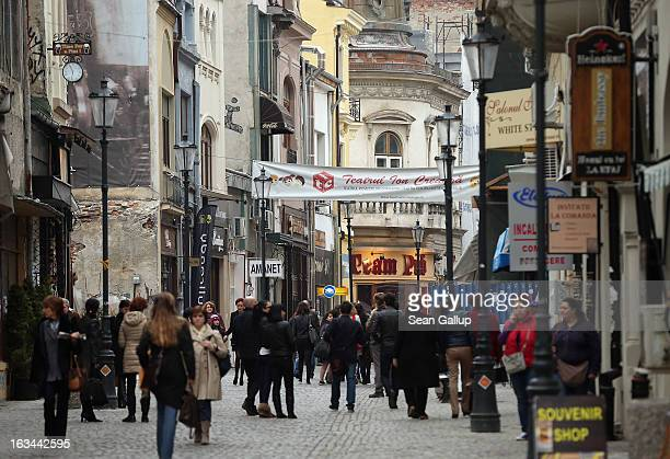 People stroll through the Lipscani old town quarter on March 8 2013 in Bucharest Romania Both Romania and Bulgaria have been members of the European...