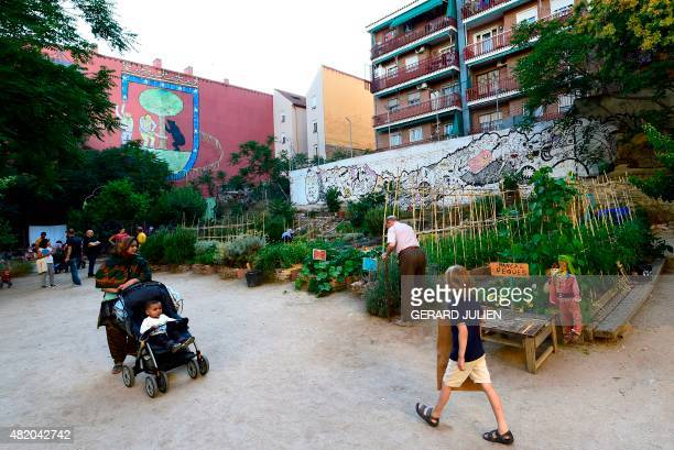 CUENCA People stroll through the urban and community garden 'Esta es una Plaza' in Madrid on June 17 2015 'For me and for many others it's like...