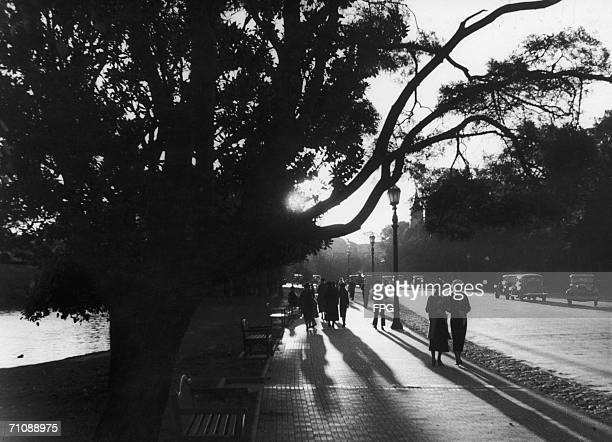 People strolling in Palermo the park section of Buenos Aires in the evening light circa 1930