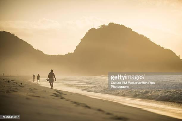 People strolling on Copacabana beach at dawn, Rio De Janeiro, Brazil