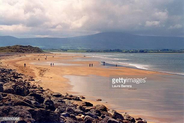 People strolling on Irish beach