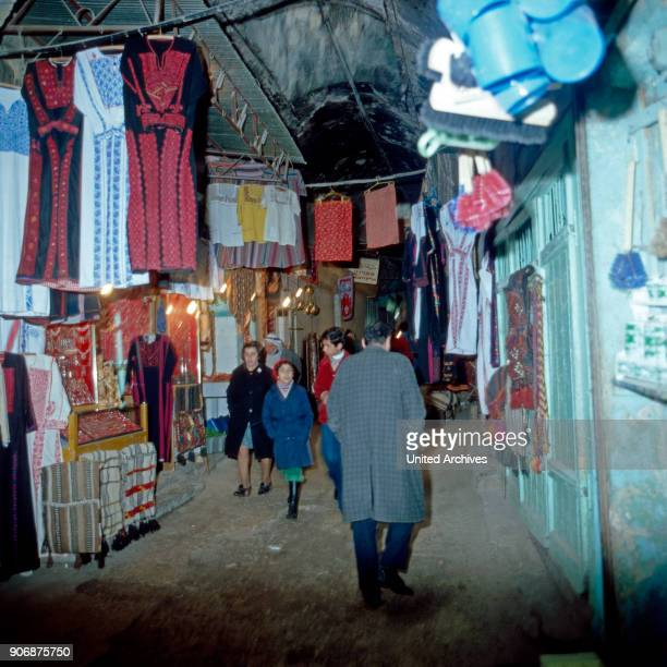 People strolling through the Arabic souk at Hebron, Israel late 1970s.