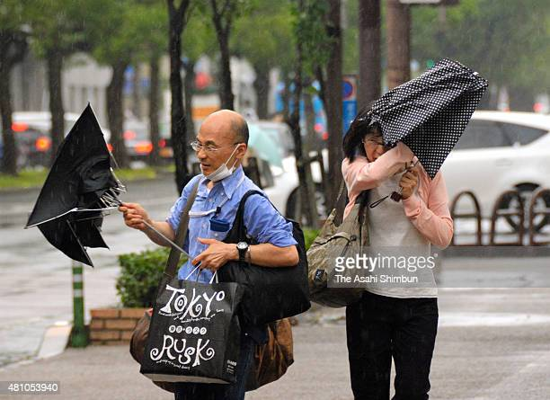 People struggle to hold umbrellas as the Typhoon Nangka approaching on July 16 2015 in Takamatsu Kagawa Japan The typhoon is expected to hit Western...