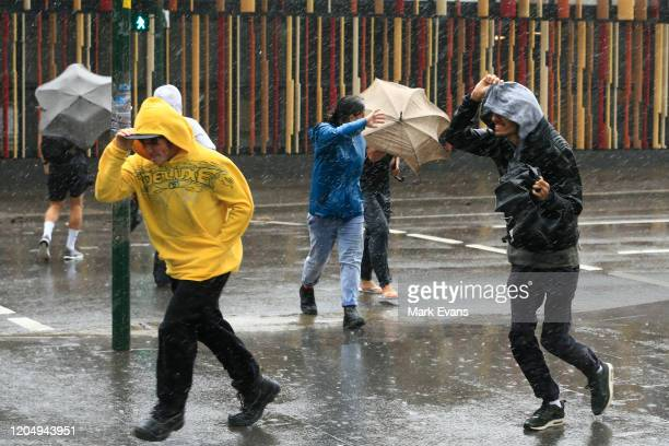 People struggle with the wind and rain on February 09 2020 in Sydney Australia The Bureau of Meteorology has forecast heavy rainfall across Sydney...