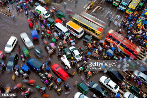 People stuck middle in a traffic jam in Poltan In the last 10 years the average traffic speed in Dhaka has dropped from 21 km/hour to 7 km/hour only...