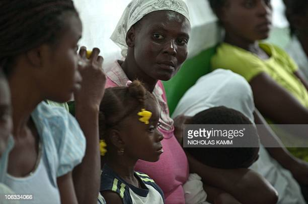 People suffering from dehydration and diarrhea wait to be treated at the Charles Colinon hospital in Petite Riviere on the Artibonite River believed...
