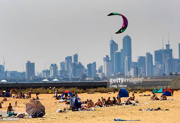 People sunbath at Brighton Beach on January 14 2014 in Melbourne Australia Temperatures are expected to reach over 40 degrees Celsius in parts of...