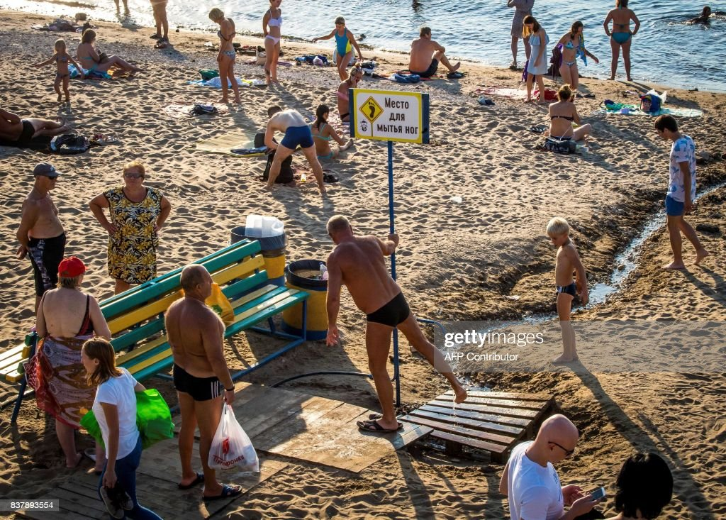 People Sunbathe At A Beach On The Volga River In Downtown Samara - The volga river