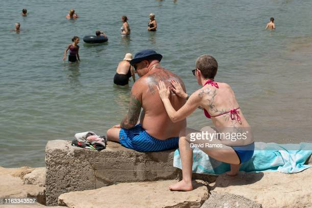 People sunbathe at Levante Beach on July 21 2019 in Benidorm Spain More than 39 million of tourists are expected to visit Spain by the end of July 7%...