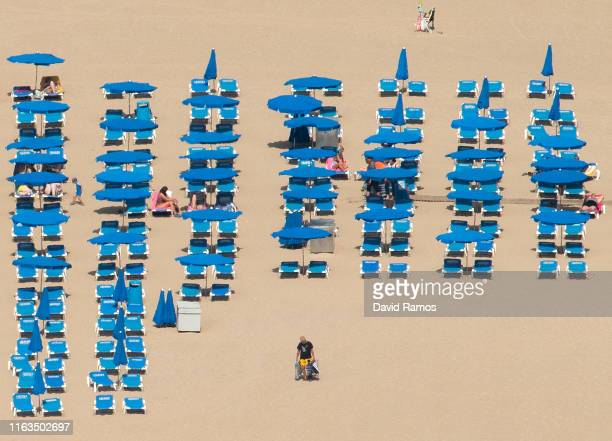 People sunbathe at Levante Beach on July 22 2019 in Benidorm Spain More than 39 million of tourists are expected to visit Spain by the end of July 7%...