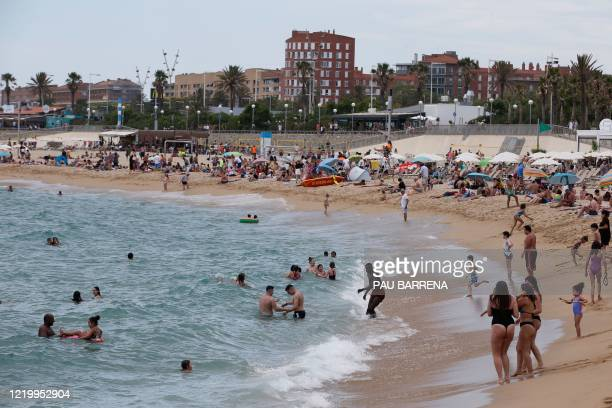People sunbathe at the Bogatell beach in Barcelona on June 14 2020 Spain will reestablish free travel with fellow EU countries on June 21 except...