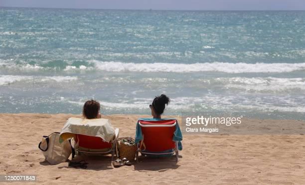 People sunbathe in Arenal beach on June 16 2020 in Palma de Mallorca Spain Spain will reopen it's borders on June 21
