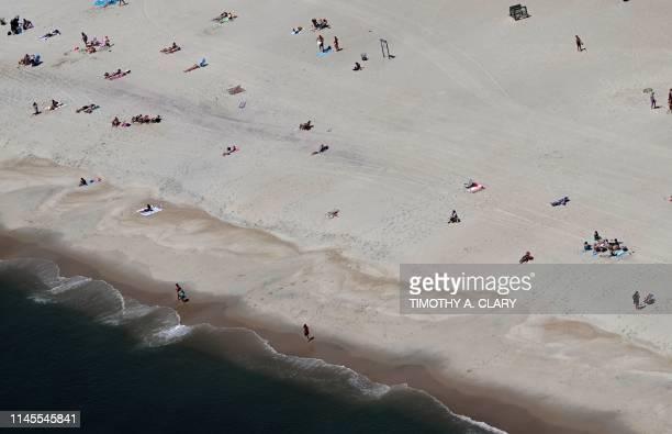 People sunbathe on Jones Beach in Long Island New York on May 22 2019
