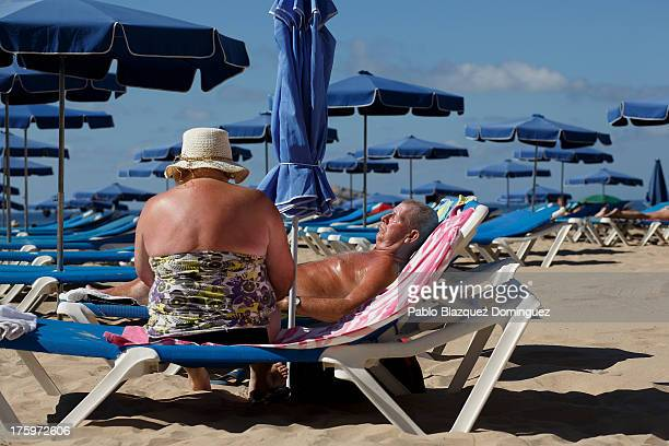 People sunbathe on Levante Beach on August 10 2013 in Benidorm Spain Benidorm is one of Europe's top package holiday destinations and one of Spain's...