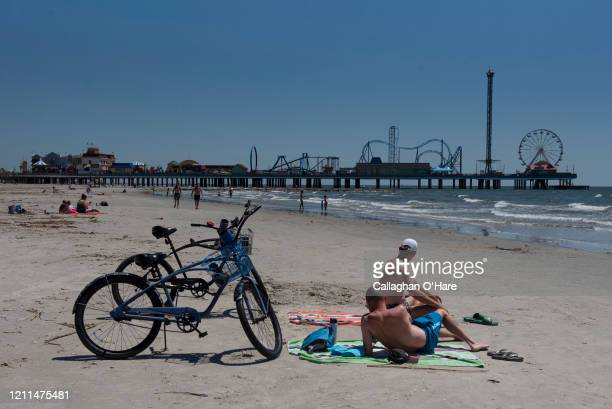 People sunbathe on the beach after it was reopened on May 1 2020 in Galveston Texas As part of phase one Gov Greg Abbott reopened the beaches to the...