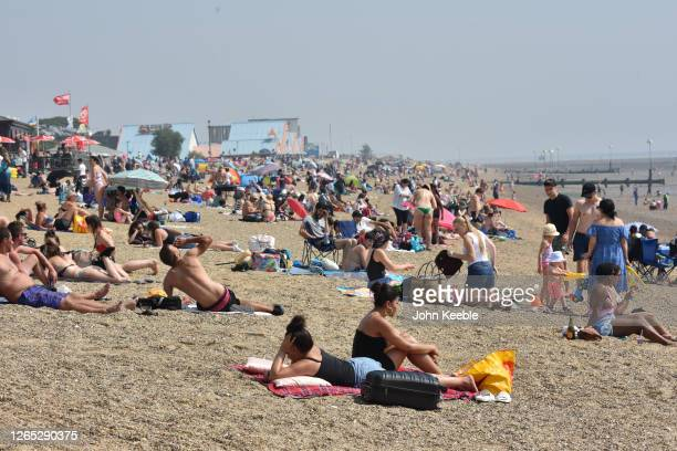 People sunbathe on the beach during the recent hot weather on August 11, 2020 in Southend on Sea, England. Parts of the UK remain in the grip of a...