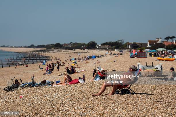 People sunbathe on the beach during the warm weather on Bank Holiday Monday on May 7 2018 in Bognor Regis United Kingdom Britons across the country...