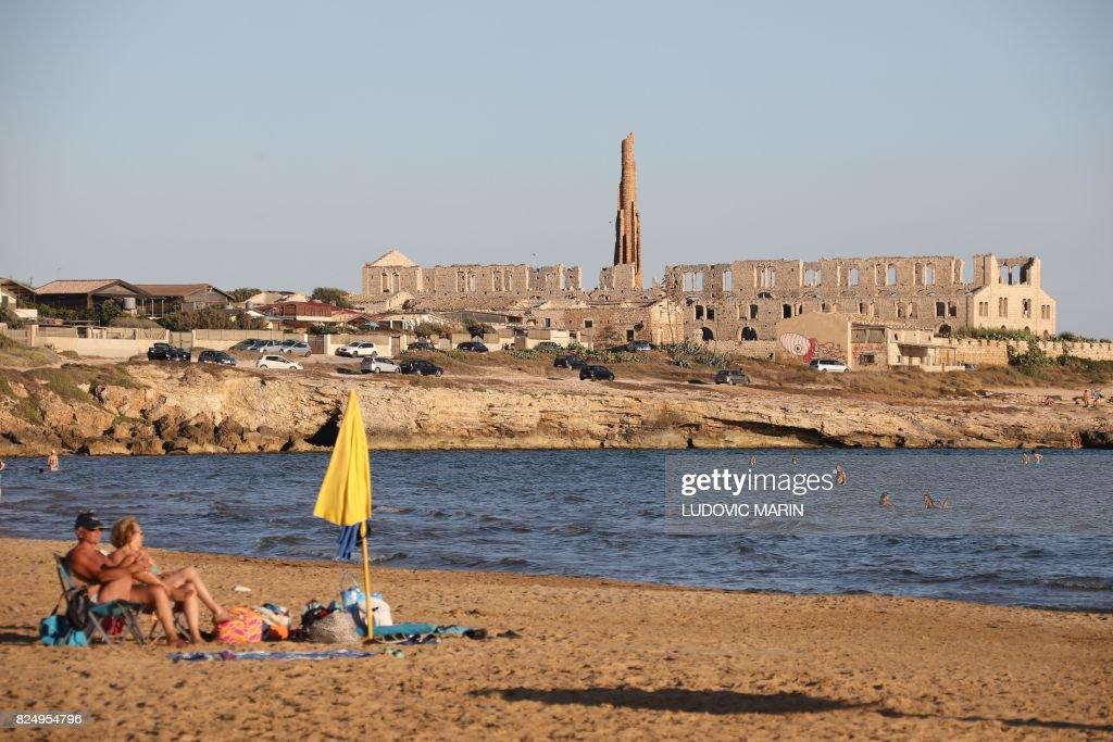 People Sunbathe On The Beach Of Sampieri Sicily On July - 2017 july 31