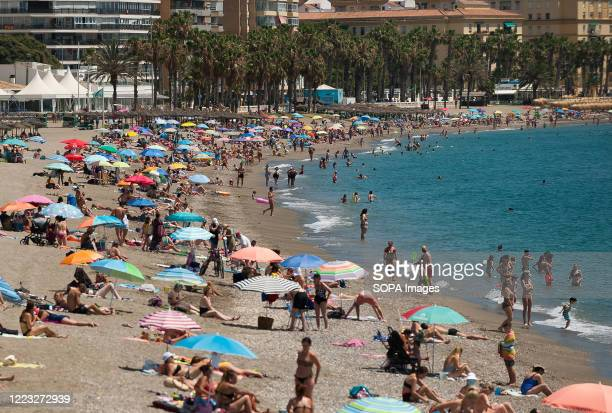 People sunbathing at La Malagueta beach during a hot summer day A heatwave crosses the country with high temperatures according to the Spanish...