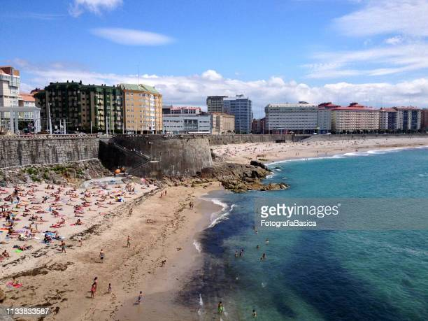 people sunbathing in the beach - a coruna stock pictures, royalty-free photos & images