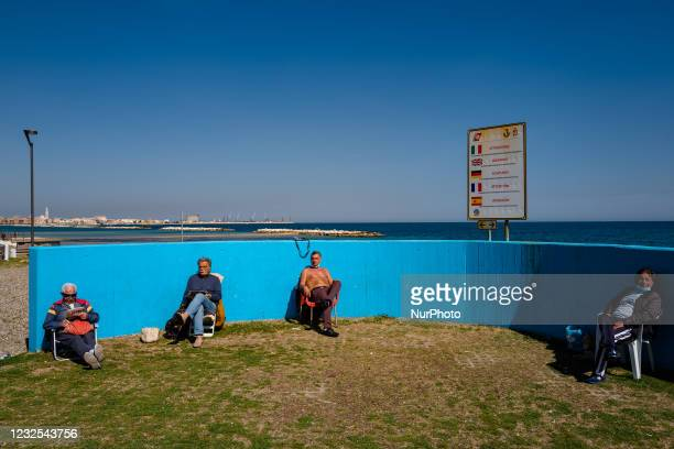 People sunbathing on the first day in the orange zone after more than a month in Bari on April 26, 2021. Italy tries to restart and Puglia from this...