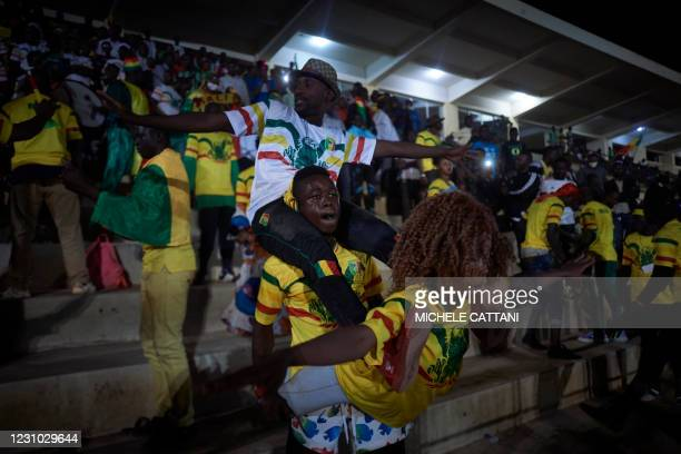 People support the Malian football team during the projection of the final match of the African Nations Championship between Mali and Morocco in the...