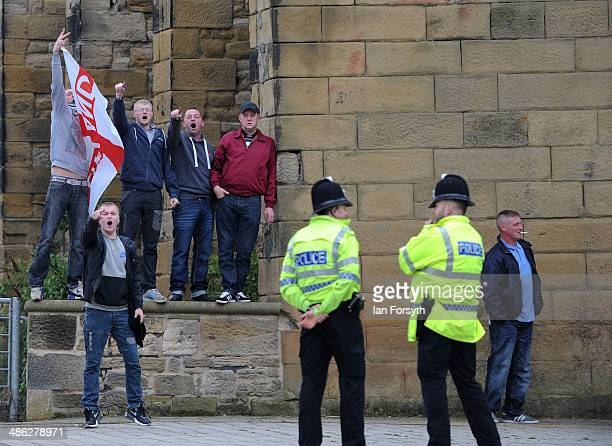 People supporting the English Defence League chant before the start of a public meeting where the UK Independence Party leader Nigel Farage spoke in...