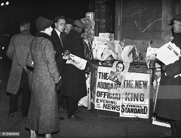 People surround a newspaper stand in Parliament Square London to read the news of King Edward VIII's abdication