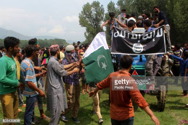 People surround near the dead body of Slain kashmiri Rebel Arif Nabi Dar Alias Arif Lilhar during a Funeral at in Lilhar about 35 kilometers south of...