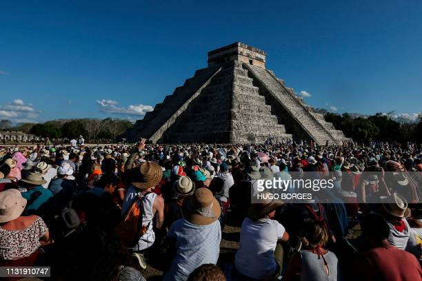 TOPSHOT People surround the Kukulcan Pyramid at the Mayan archaeological site of Chichen Itza in Yucatan State Mexico during the celebration of the...