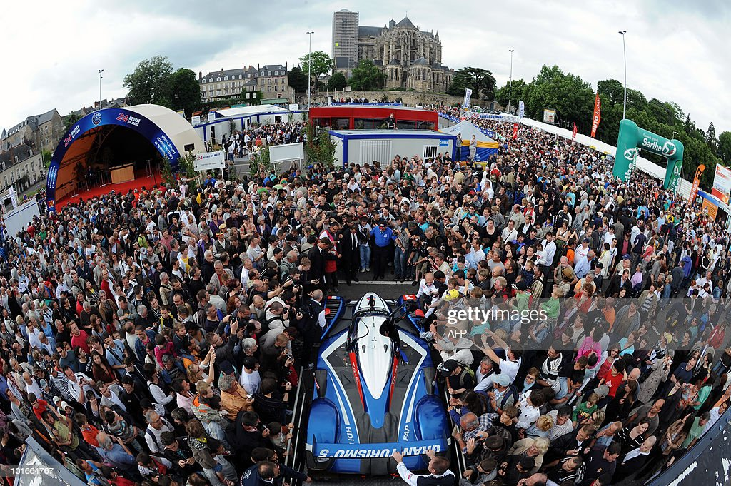 People surround the last year Le Mans 24-hour winning car, the Peugeot 908 HDi FAP, on June 6, 2010 in Le Mans, western France, during its presentation. Fifty-six cars with 168 drivers will participate on June 12 and 13 in the 78th edition of the Le 24-hour endurance race.