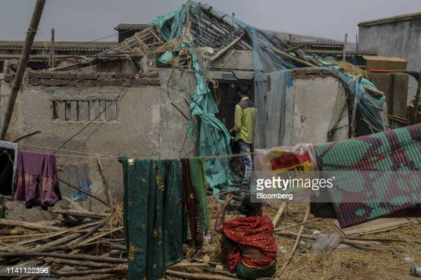 People survey a damaged home after Cyclone Fani passed through Puri Odisha India on Saturday May 4 2019 A category 4 storm with strong wind and heavy...