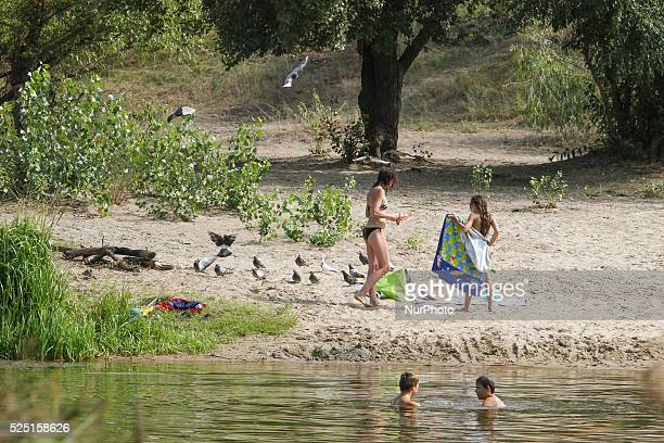 People swim and sunbathe on the shore of Verbne lake in Kiev where several people were deadly infected with leptospirosis. Several people were deadly...