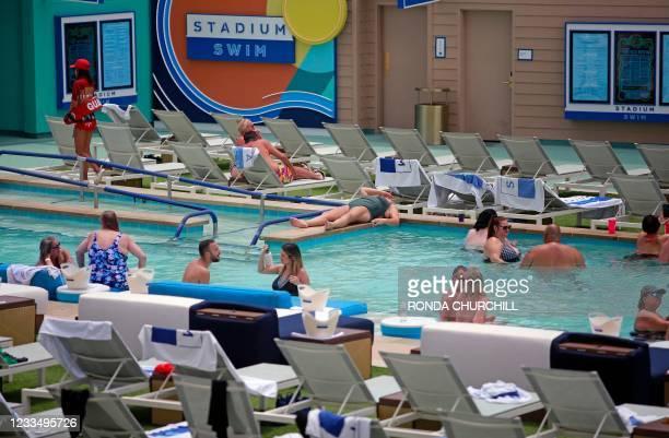 People swim at the Circa hotel-casino's Stadium Swim pool during an excessive heat warning, June 16 in Las Vegas, Nevada.