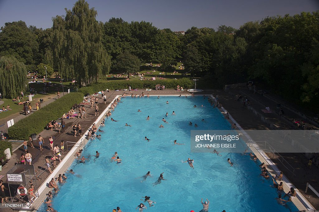Public Swimming Pools With People Swim In A Pool On July 23